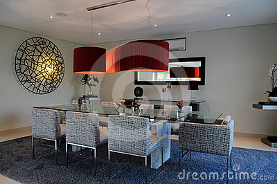 Elegant Dinning Space with Red Ceiling Lampshade