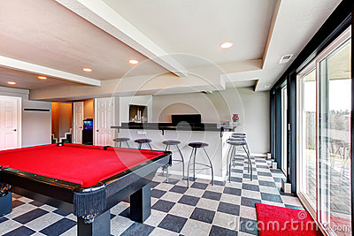 Elegant entertainment room with pool, bar and fireplace