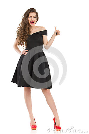 Free Elegant Excited Woman In Black Dress Gives Thumb Up Stock Photos - 93790043