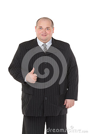 Elegant fat man in a black suit shows thumb-up