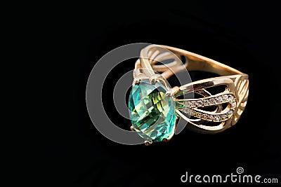 Elegant female jewelry with emerald