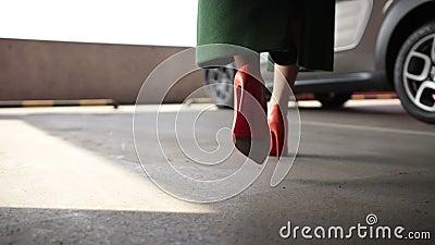 Elegant female legs walking to parked car stock video footage