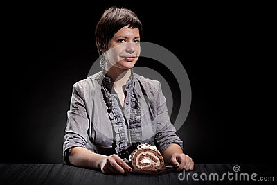 Elegant girl eating a chocolate cake
