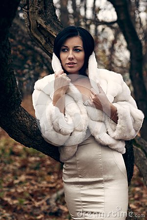 Elegant girl in white coat with high collar