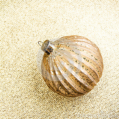 Elegant Gold Christmas background with golden ball. Holiday  Gli