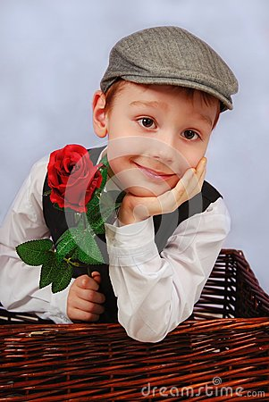 Elegant little boy with rosa