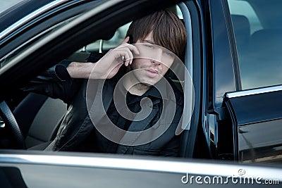 Elegant man in a car