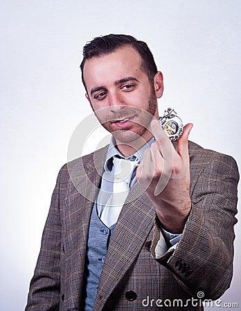 Elegant man looking his old pocket watch