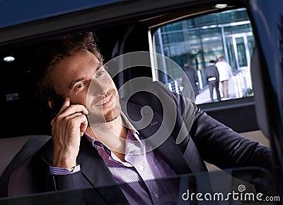 Elegant man in luxury automobile smiling
