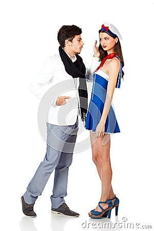 Elegant man seducing a beautiful sailor woman