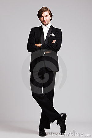 Elegant man in tuxedo full body shot