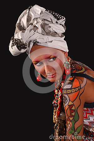 Elegant model with bright makeup and body art.
