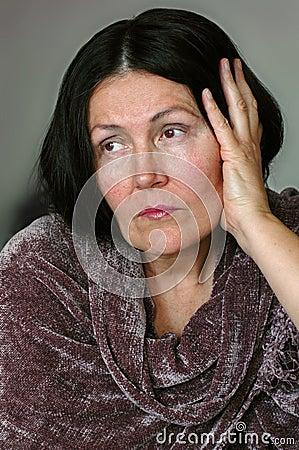 Elegant but sad older woman