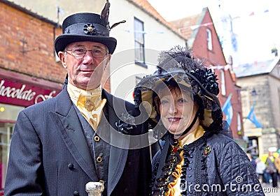 Elegant senior couple in vintage costume. Editorial Photo