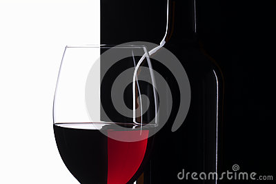 Elegant symmetry red wine glass and a wine bottle