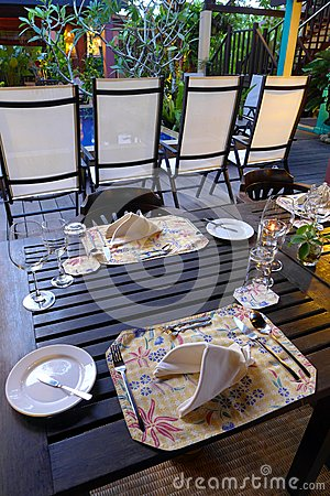 Elegant table cutlery setting, outdoor garden