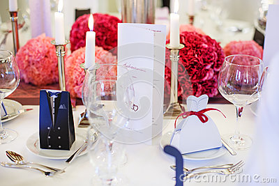Elegant table set  for wedding or event party in soft red and pi