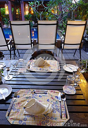 Elegant table setting  outdoors, ethnic batik