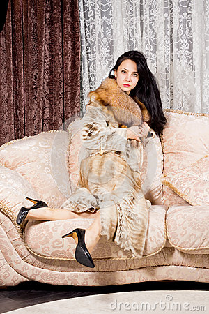 http://thumbs.dreamstime.com/x/elegant-wealthy-woman-long-brunette-hair-sitting-comfortably-upholstered-sofa-clutching-her-luxurious-fur-coat-around-her-29762725.jpg