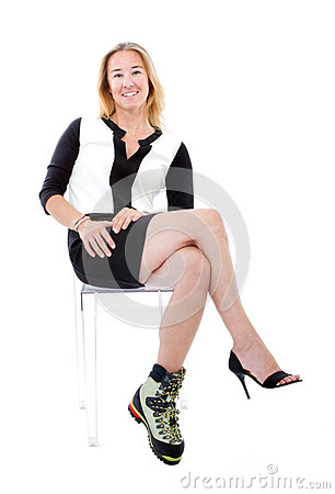 Elegant woman with bizarre climbing boot