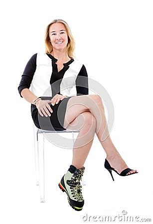 Elegant woman with bizarre climbing boot