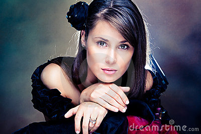 elegant woman in black dress portrait
