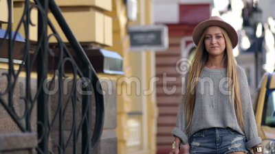 Elegant woman carrying shopping bags and smiling stock video footage