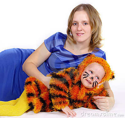 Elegant woman and the girl in a suit of a tiger