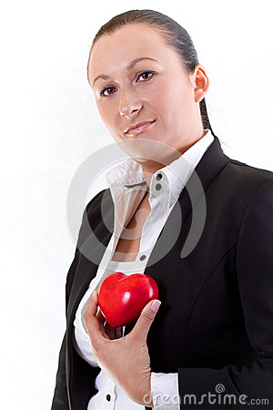 Elegant woman holding red heart