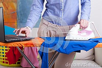 Elegant woman during ironing