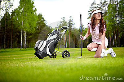 Elegant woman playing golf
