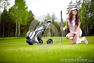Elegant woman playing golf