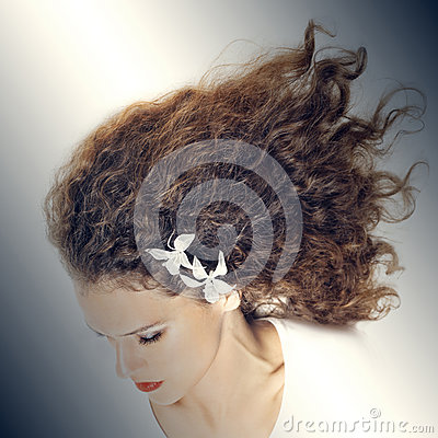 Elegant woman with curly hair