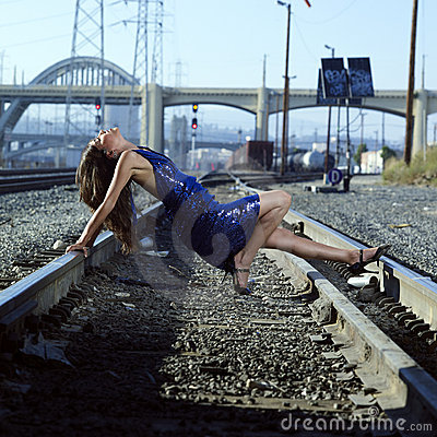 Elegant Woman on Railroad Tracks