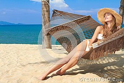 Elegant woman reclining in a hammock