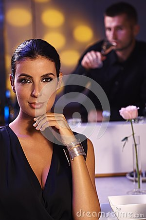 Elegant woman sitting at dinner table