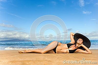 Elegant woman smiling on beach