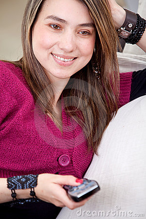 Elegant woman with a television remote control