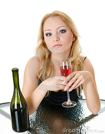 Elegant woman with wine in hands in cafe
