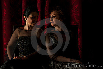 Elegant women in darkness