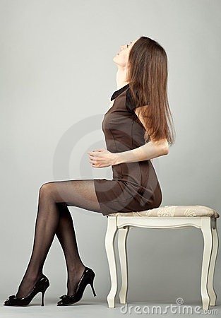 Free Elegant Young Brunette Sitting On A Banquette Royalty Free Stock Photo - 23431745
