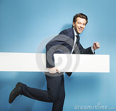 Elegant young man running with the board