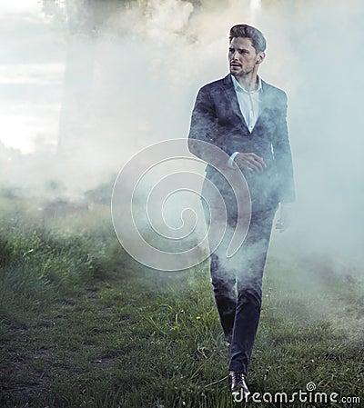 Free Elegant Young Man Walking In The Morning Haze Stock Image - 95992391