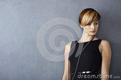 Elegant young woman in black dress