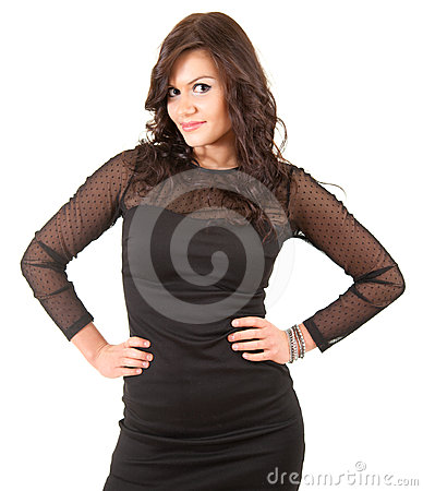 Elegant young woman with hands on waist