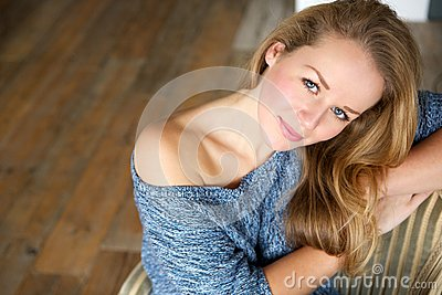 Elegant young woman relaxing at home