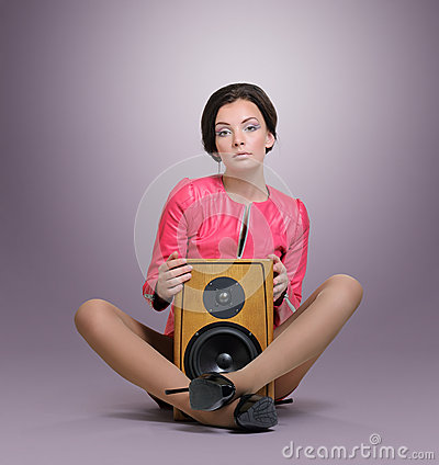 Elegant young woman with speaker, relax party concept