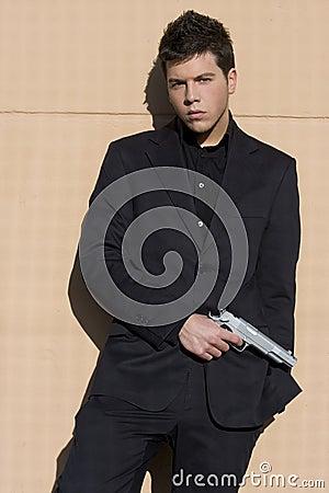 Elegantly dressed armed man.