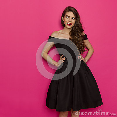 Free Elegany Young Woman In Black Cocktail Dress Is Looking Away Stock Images - 94826694