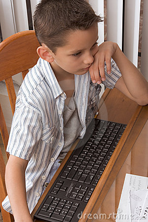 Elementary age (8 years) kid plays computer game